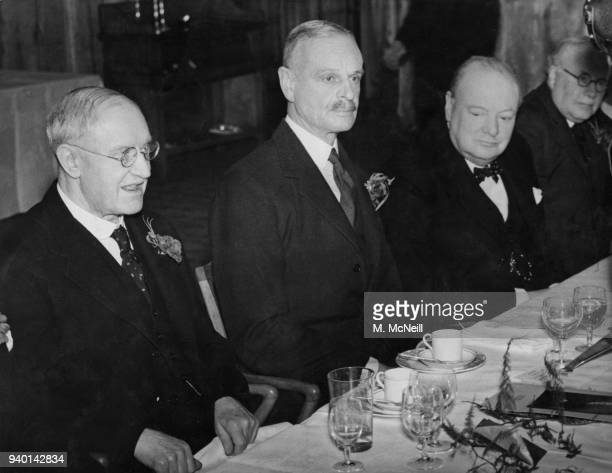 From left to right Sir Emsley Carr John Jacob Astor and British Prime Minister Winston Churchill at a luncheon at the Dorchester Hotel in London to...