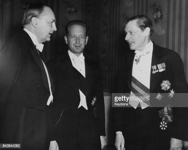 From left to right Sir Gladwyn Jebb the new British Ambassador to Paris Swedish diplomat Dag Hammarskjold SecretaryGeneral of the United Nations and...