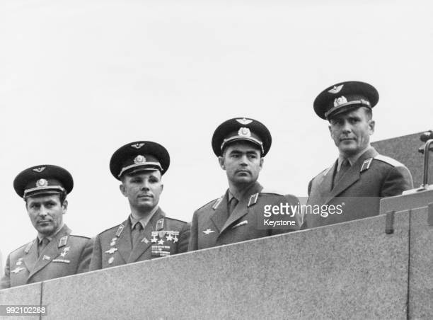From left to right Soviet cosmonauts Gherman Titov Yuri Gagarin Andriyan Nikolayev and Pavel Popovich pose on the Tribune of the Lenin Mausoleum in...