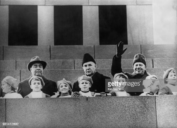 From left to right Soviet leaders Leonid Brezhnev Alexei Kosygin and Nikolai Podgorny with a group of children on Lenin's Mausoleum Red Square Moscow...
