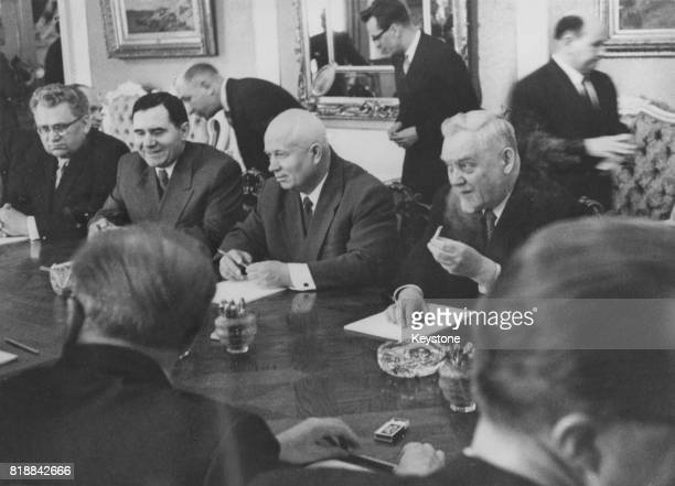 From left to right Soviet statesmen Viktor Lebedev Andrei Gromyko Nikita Khrushchev and Nikolai Bulganin attend a conference in Helsinki Finland June...