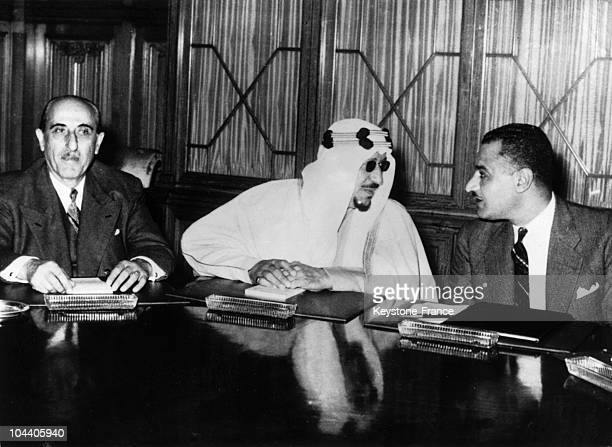 From left to right Syrian President Shukry EL KOWATLY King IBN SAUD of Saudi Arabia and Egyptian Prime Minister Gamal Abdel NASSER talking during a...