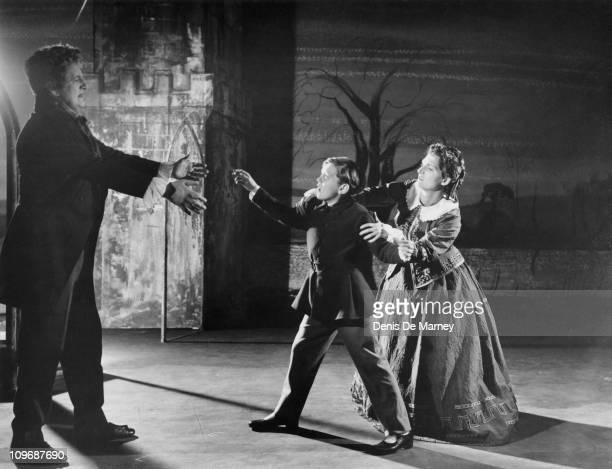 From left to right Tenor Peter Pears as Quint child soprano David Hemmings as Miles and Jennifer Vyvyan as the Governess in the English Opera Group's...