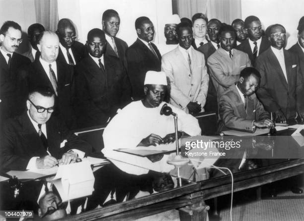 From left to right the Minister of France's overseas territories and departments Louis JASQUINOT president of the Malian Republic Modibo KEITA...