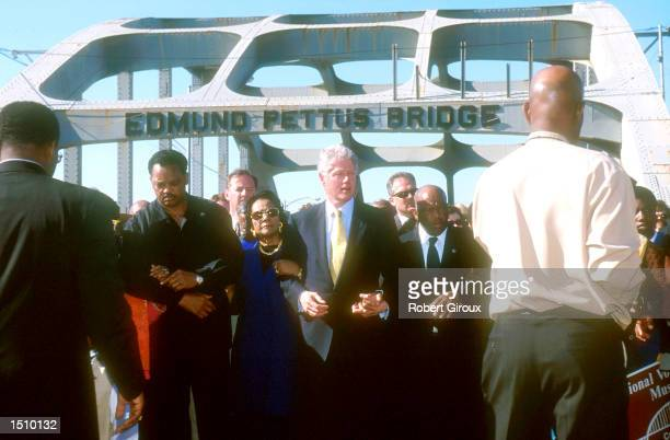 From left to right, the Reverend Jesse Jackson, Coretta Scott King, President Bill Clinton and Representative John Lewis join arms as they walk with...