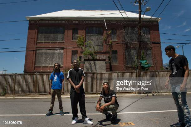 From left to right Tony Crews 18 Antwan Williams 19 Burke 'YB'' Davis 20 and Willis Little shown in front of the closed Crummell School advocate for...