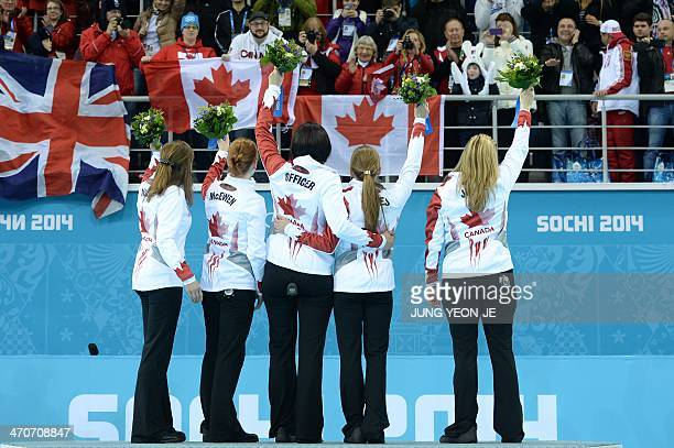 Canadian gold medalists Kirsten Wall Dawn McEwen Jill Officer Kaitlyn Lawes and Jennifer Jones celebrate on the podium in the Women's Curling Flower...