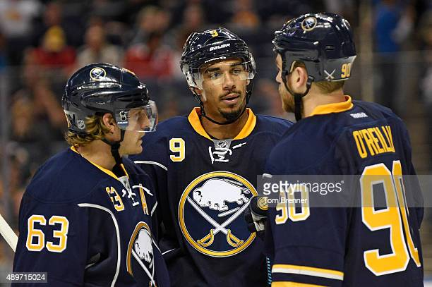 From left to right Tyler Ennis Evander Kane and Ryan O'Reilly of the Buffalo Sabres talk inbetween whistles during a game against the Ottawa Senators...
