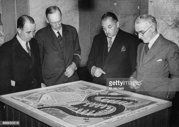 From left to right unknown J F Collin the Chief Housing Inspector at the Ministry of Health Ernest Brown the Minister of Health and Arthur Kenyon...
