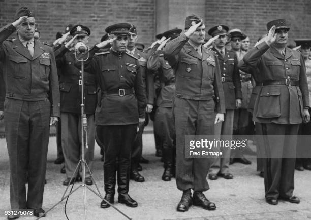 From left to right, US General Omar Bradley, Russian Major General Nikolai Barinov, US Major General Floyd L. Parks, chief of the Airborne Army of...