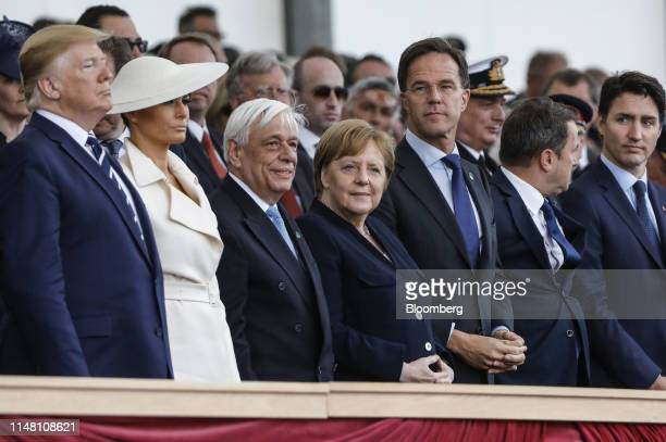 From left to right US President Donald Trump US First Lady Melania Trump Prokopis Pavlopoulos Greece's president Angela Merkel Germany's chancellor...