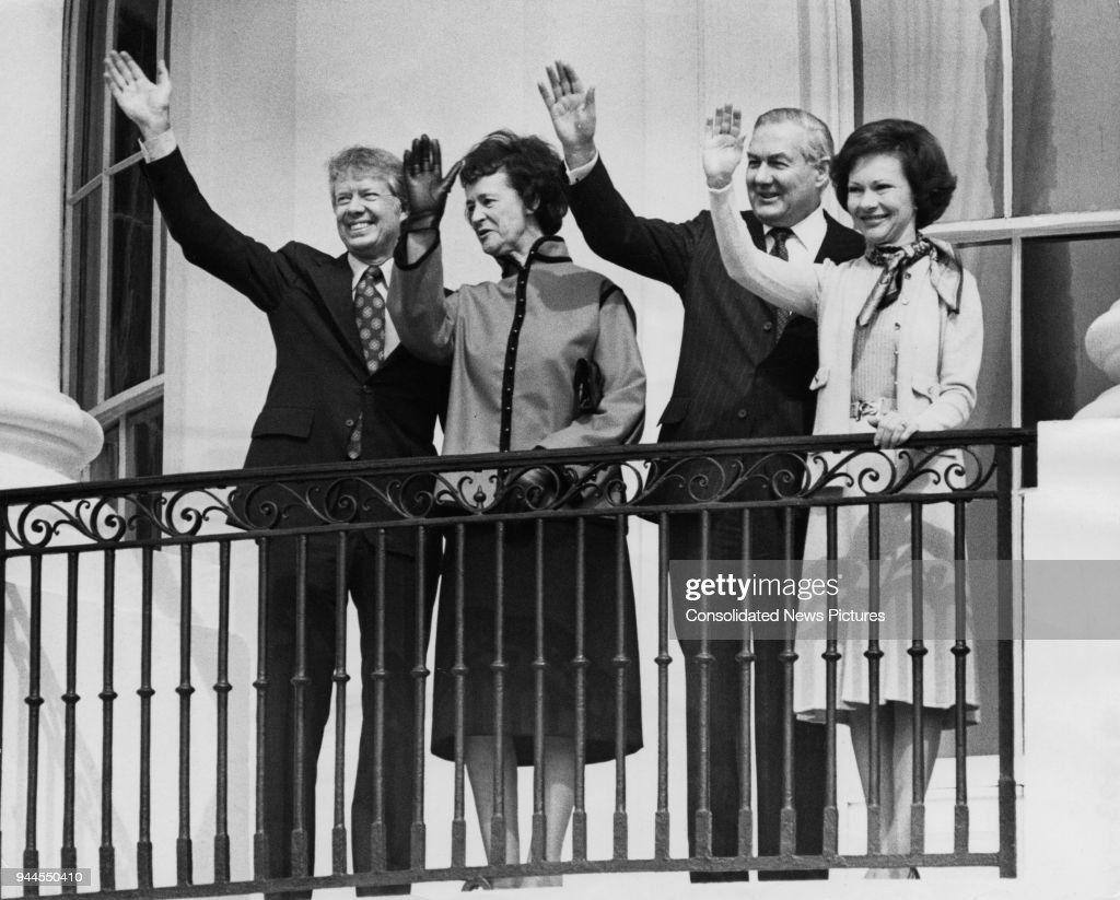 From left to right, US President Jimmy Carter, Audrey Callaghan, British Prime Minister James Callaghan (1912 - 2005) and Rosalynn Carter waving from the South Portico Balcony of the White House in Washington, DC, during an official visit by Callaghan, 10th March 1977.