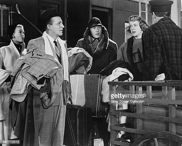 From left to right VeraEllen Bing Crosby Danny Kaye Rosemary Clooney and an unknown actor in a scene from the musical film 'White Christmas' 1954