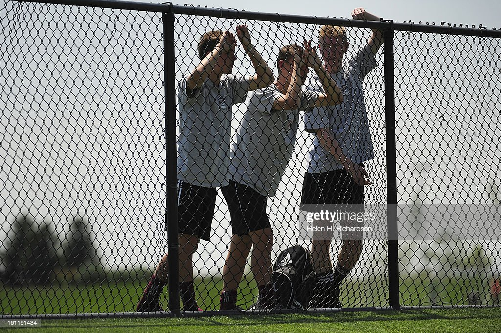 From left to right Victor Rolph, 15, Remington Ellis, 16, and Tristen Heath, 16, at the Dick's Sporting Goods Park for the U16 Developmental Academy soccer program, watch the Colorado Rapids as they practice today July 11, 2012. The team practiced on prac : News Photo