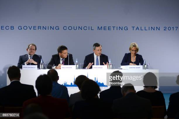 From left to right Vitor Constancio vice president of the European Central Bank Ardo Hansson governor of the Estonian central bank Mario Draghi...