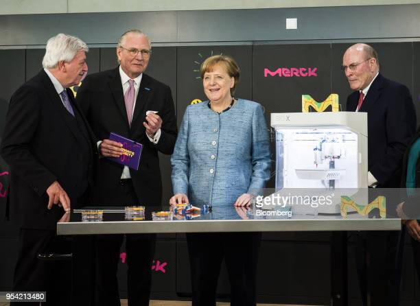 From left to right Volker Bouffier premier of the German state of Hesse Stefan Oschmann chief executive officer of Merck KGaA Angela Merkel Germany's...