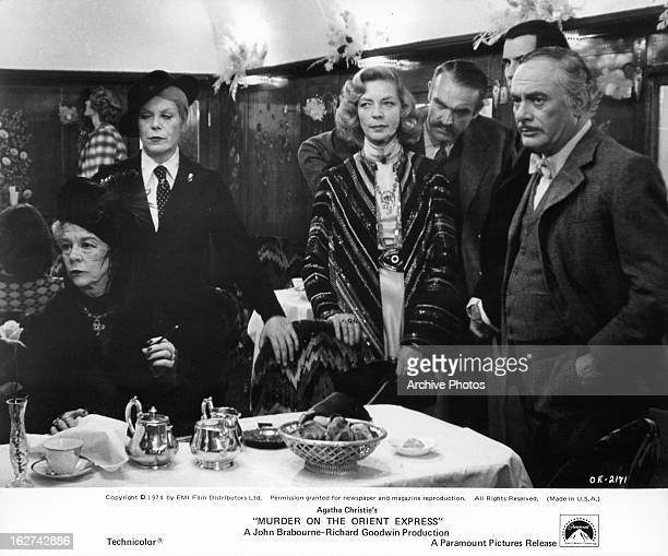 From left to right Wendy Hiller Rachel Roberts Lauren Bacall and Martin Balsam at dinner in a scene from the film 'Murder On The Orient Express' 1974