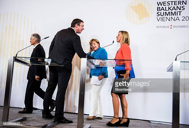 From left to right Werner Faymann Austria's chancellor Aleksandar Vucic Serbia's prime minister Angela Merkel Germany's chancellor and Federica...