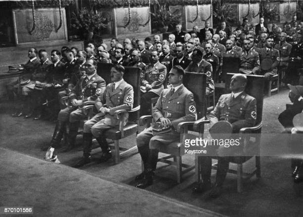 From left to right Willy Liebel Burgomaster of Nuremberg with Nazi Party officials Adolf Hitler Rudolf Hess and Julius Streicher as they receive the...