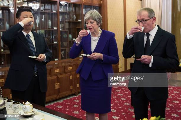 From left to right Xi Jinping China's president Theresa May UK prime minister Philip May husband of UK Prime Minister Theresa May drink tea during a...
