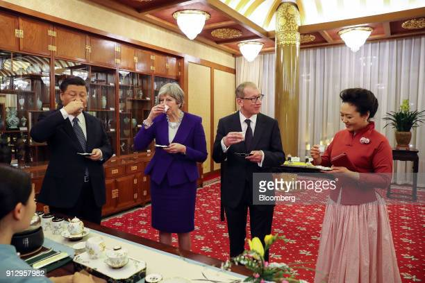 From left to right Xi Jinping China's president Theresa May UK prime minister Philip May husband of UK Prime Minister Theresa May and Peng Liyuan...
