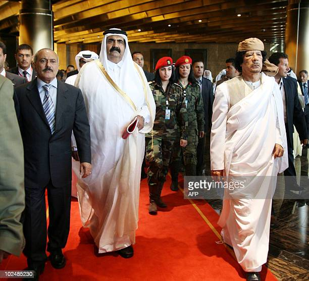 - Yemeni President Ali Abdullah Saleh, Emir of Qatar Sheikh Hamad bin Khalifa al-Thani and Libyan leader Moamer Kadhafi, are escorted by female...