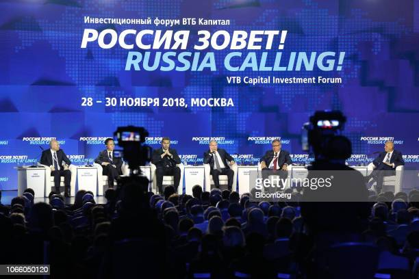 From left to right Yuri Soloviev first deputy chief executive officer of VTB Group Simon Shangguan chief executive officer of GF International...