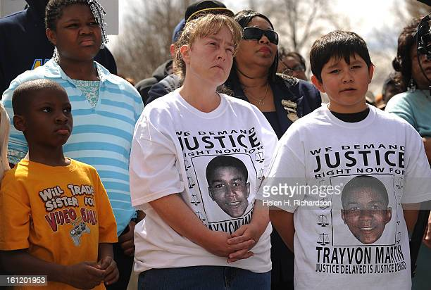 From left to right Zamasgeon Caldwell Qiae'janae Kelly Denise and Julius Aerts 10 listen during the rally A rally was held in City Park at the Martin...