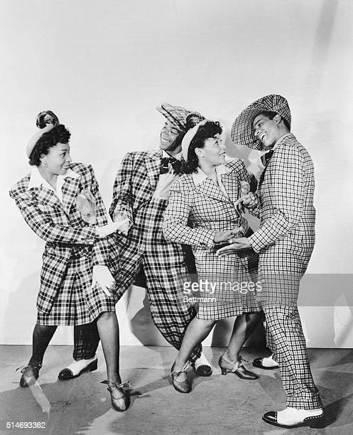 From left to right, zoot-suited hepcats Patsy Hunter, Wynonie Harris, Neva Peoples, and James Burch dance in a publicity still from Republic...