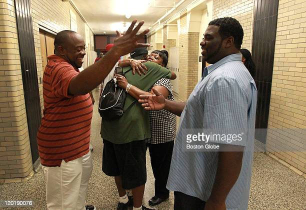 From left to rightL Kevin Bonner class of 1987 who played quarterback for the school's football team greets former teammate Howard Williamson