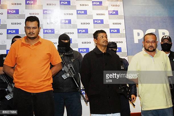 Julio Cesar Mondragon Mendoza Juan Carlos Castro Galeana y Alfredo Rosas Elicea members of a group of hitmen called the Zetas are shown to the press...