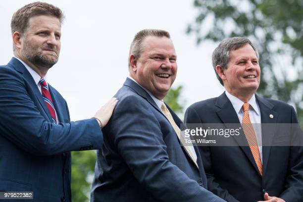From left Tom Cors of The Nature Conservancy Sens Jon Tester DMont and Steve Daines RMont attend a news conference on the upcoming expiration of the...