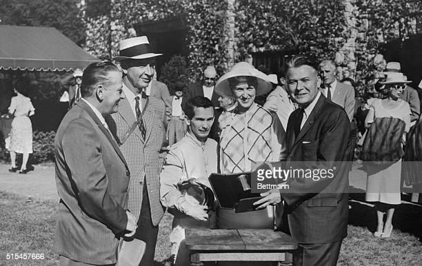From left: trainer R. L. Wheeler, owner Cornelius V. Whitney, jockey Willie Shoemaker, and Mrs. Whitney pose for pictures as Kentucky Governor Bert...