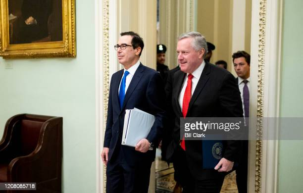 From left Treasury Secretary Steven Mnuchin and incoming White House Chief of Staff Rep Mark Meadows RNC walk through the Capitol on their way to...