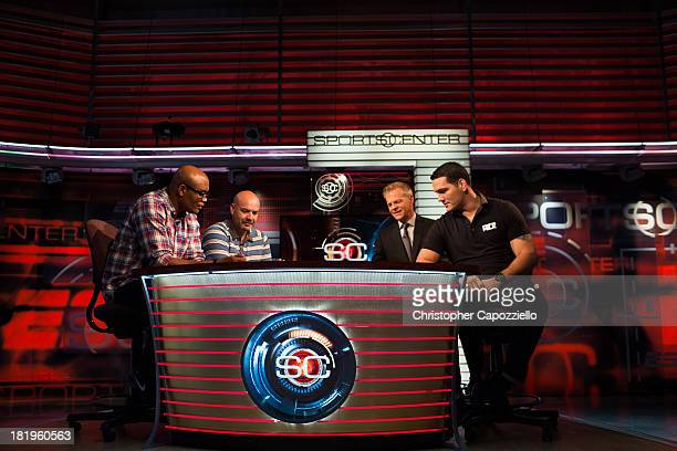 From left UFC middleweight fighter Anderson Silva is joined by his manager and translator Ed Soares while ESPN Sportscenter anchor David Lloyd middle...