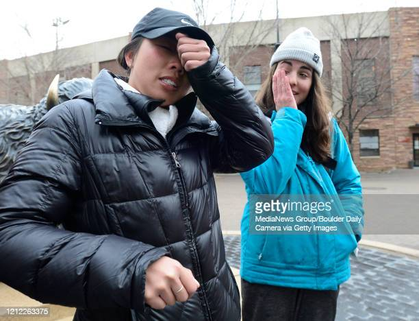 University of Colorado Boulder seniorsThuyminh Tran and Jordan Eches react to changes in campus life in Boulder on March 13 2020 They were walking...