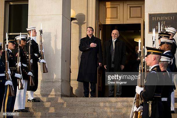 From left, U.S. Defense Secretary Ash Carter welcomes Afghan President Ashraf Ghani as they listen to the national anthem from both countries during...