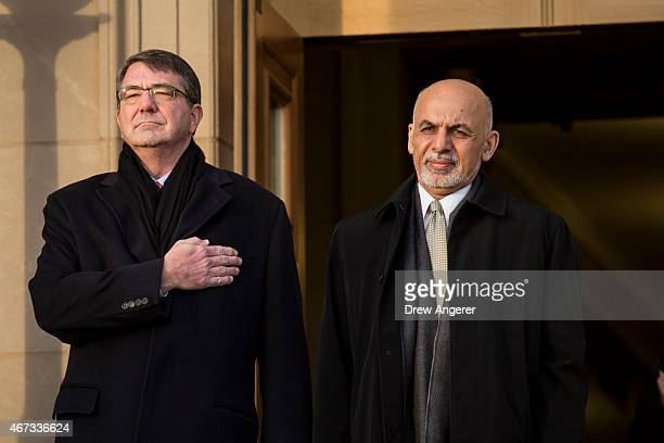 From left US Defense Secretary Ash Carter welcomes Afghan President Ashraf Ghani as they listen to the national anthem from both countries during an...