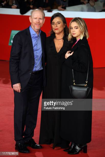 From Left US director Ron Howard Giuliana Pavarotti the daughter of late Italian tenor Luciano Pavarotti and Luciano Pavarottis granddaughter...