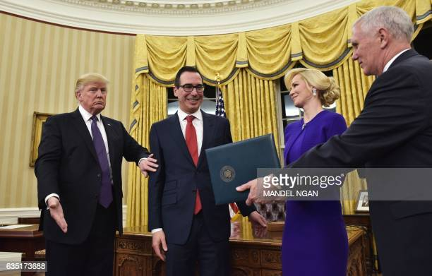 President Donald Trump, Steven Mnuchin, his financee Louise Linton, and US Vice President Mike Pence take their positions for Mnuchin's swearing-in...