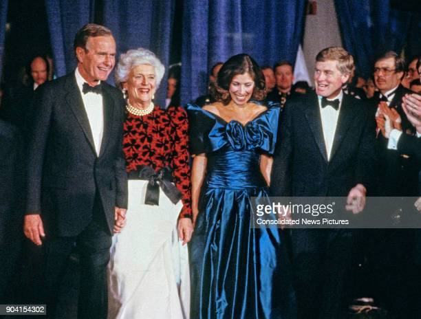From left US PresidentElect George HW Bush Barbara Bush Marilyn Quayle and Vice PresidentElect Dan Quayle attend the Black Tie and Boots Inaugural...