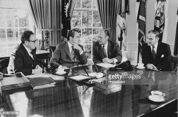 From left US Secretary of State Henry Kissinger and US President Richard Nixon listen to Congressman and vice presidentdesignate Gerald R Ford with...