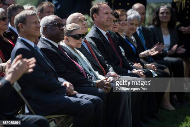 From left US Supreme Court Chief Justice John Roberts and associate justices Clarence Thomas Ruth Bader Ginsburg Stephen Breyer Samuel Alito and...