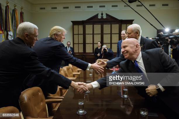From left US Vice President Mike Pence US President Donald Trump Senator Ron Wyden Rep Kevin Brady and Senator Orrin G Hatch greet each other before...