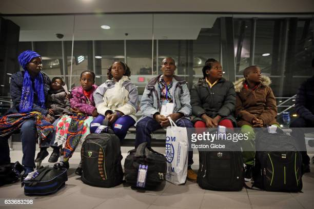 From left Vanisi Uzamukunda Sarah Lea Maria Sendegeya Bayavuge Nyirakabanza Dusenge 15 wait for their baggage at the ManchesterBoston Regional...