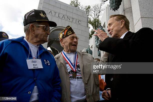 From left veterans Don Rice of Melvern Kansas and Clarence Mai of Wakeeney Kansas share a laugh with former Senator and fellow veteran Bob Dole at...