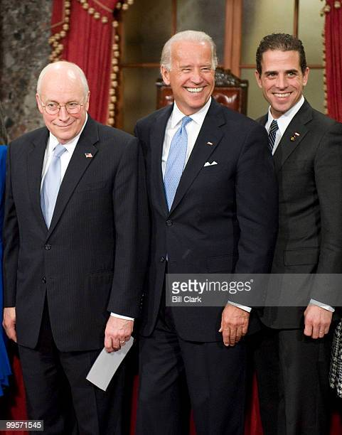 From left Vice President Dick Cheney Vice President elect Joe Biden and his son Hunter Biden pose for photos following Sen Biden's mock swearing in...