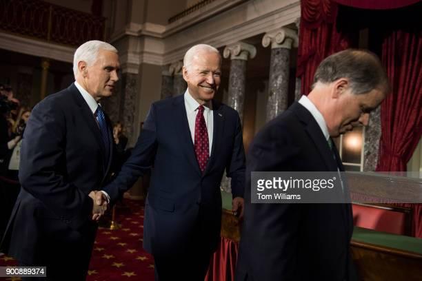 From left Vice President Mike Pence former VP Joe Biden and Sen Doug Jones DAla attend a swearingin ceremony for Jones and and Sen Tina Smith DMinn...