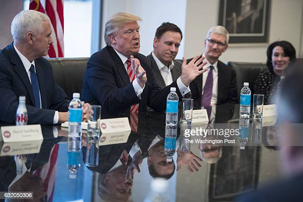From left Vice Presidentelect Mike Pence PayPal founder Peter Thiel Apple CEO Tim Cook and Oracle CEO Safra Catz listen to Republican...