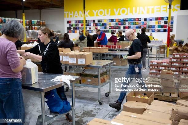 Volunteer Molly Matles and volunteer logistics coordinator Blair Kearney at the Alameda County Community Food Bank on Thursday, Jan. 17 in Oakland,...